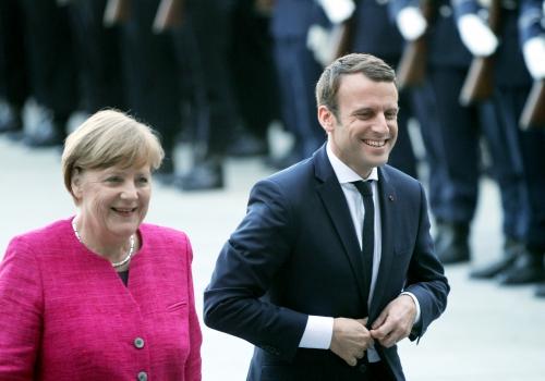 Merkel räumt Meinungsverschiedenheiten mit Macron ein