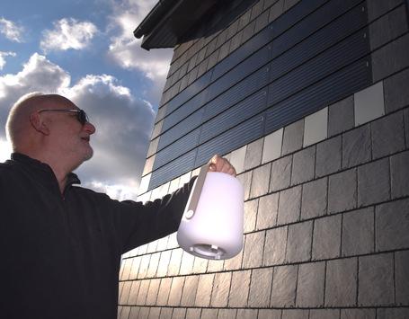 Wo die Wand das Licht macht – Naturfassade aus Schiefer schützt, dämmt und liefert Energie